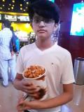 Movie-goer, popcorn-eater