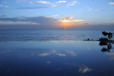 Sunset with the Atlantic Ocean and the infinity pool of the Conakry Sheraton Grand