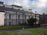 Brutal looking caged prison yard on the back side of Londonderry Court House