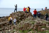 Tourists atop the basalt pillars of Giant's Causeway