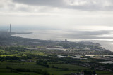 Carrickfergus and the tower of the Kilroot Power Station from the Knockagh Monument