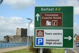 Causeway Coastal Route as it passes Carrickfergus Castle on the way to Belfast