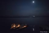 Fishermen under the moon.