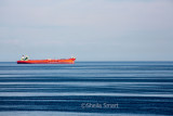 Red container boat, Ugland, in Baltic Sea web.jpg