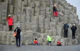Tourists and Column Basalts at Reynisfjara is a world-famous black-sand beach, Vik, Iceland 1690