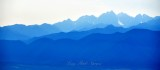 Mount Constance and Olympic Mountains in haze and smoke from forest fire, Over Port Ludlow, Washington 138