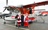 Flying Santa and Mrs Claus in Bad Kitty Kodiak Quest airplane 150a