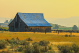 Old barn in smokefilled valley