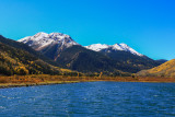 Snowcapped Red Mountain over Crystal Lake