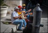 Street musicians with a bit odd instrument