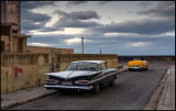 1959 Chevrolet Impala and Mercury convertible parked near Malceon