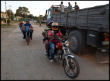 Transportation of workers with bicycle, MC and truck....