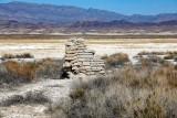 dry lake and wall ruins