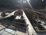 Scaffolding supporting workers in the areas beneath where the arena floor would be