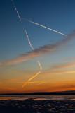Contrails around sunrise