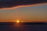 Sunrise across the Bay of Quinte with low clouds 2020 February 20.