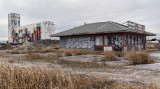 Grain Elevator and Abandoned Used Car Lot