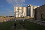 Lakin, Kansas Concrete Grain Elevators and Covered Wagon Frame.