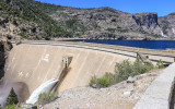 O'Shaughnessy Dam with Tueeulala and Wapama Falls in the distance in the Hetch Hetchy Valley of Yosemite NP