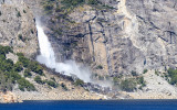Wapama Falls flowing into the reservoir in the Hetch Hetchy Valley of Yosemite NP
