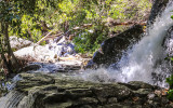 Water from Tueeulala Falls floods the Wapama Falls Trail in the Hetch Hetchy Valley of Yosemite NP