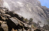 Mist from Wapama Falls crashing into the rocks at its base in the Hetch Hetchy Valley of Yosemite NP