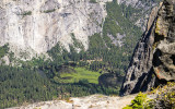 A flooded meadow along the Merced River in Yosemite Valley as seen from the Pohono Trail in Yosemite National Park