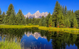 Grand Teton peaks reflected in a Snake River pond at Schwabacher Landing in Grand Teton National Park