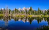 Reflection of the Grand Teton peaks in a Snake River beaver pond at Schwabacher Landing in Grand Teton National Park