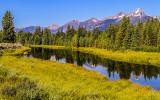 The Grand Teton Range reflected in a Snake River tributary at Schwabacher Landing in Grand Teton National Park