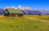 John Moulton Homestead Bunkhouse with the Grand Tetons in the background in Grand Teton National Park