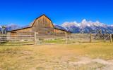 The Tetons frame the John Moulton Homestead Barn in Grand Teton National Park