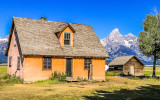 """John Moulton Homestead """"Pink House"""" with Grand Teton Peak in the distance in Grand Teton National Park"""