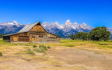 T.A. Moulton Barn along Mormon Row with the Grand Teton Range in the distance in Grand Teton National Park