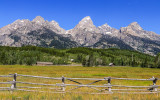 Ranch fence frames Grand Teton Peak along the Teton Park Road in Grand Teton National Park