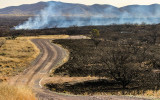 A controlled burn smolders along the Pronghorn Loop road in Buenos Aires NWR