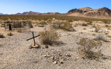 Mountains frame the Rhyolite cemetery in the Rhyolite Historic Townsite