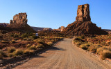 Stagecoach Rock and Castle Butte along the park road before sunset in Valley of the Gods