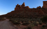 The sun behind the Rudolph and Santa Claus formation in Valley of the Gods