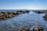 looking over the rocky shoreline to Kapiti Island