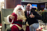 Santa came down the smokestack.  Howard saw him; I was too cozy in the room to go. (Santa with Corey, cruise director).