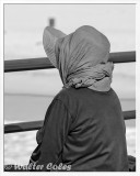 Lady in Red Hat HB Pier 2-9-15 CC AI BW Frame w.jpg
