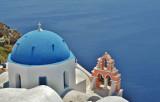 The blue domed Church of Anastasis, Oia.
