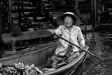 Floating market fruit vendor in Bangkok