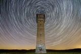 star trails around the tower