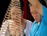 Preparing Incense Coils in Temple