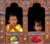 Children in a Colorful Window