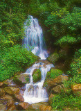 Waterfall High in the Mountains