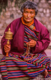 Woman with Buddhist Rosary and Prayer Wheel