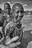 Maasai Girl Reaching Out in Friendship